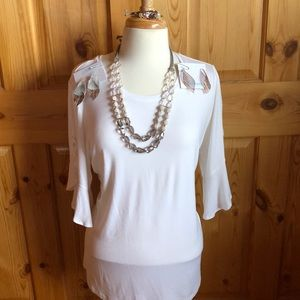 White top with flounce sleeve.